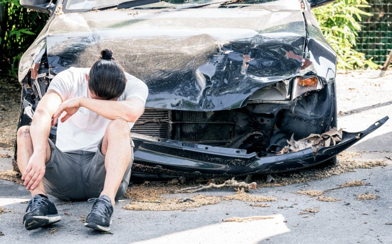 man after car accident on the side of the road